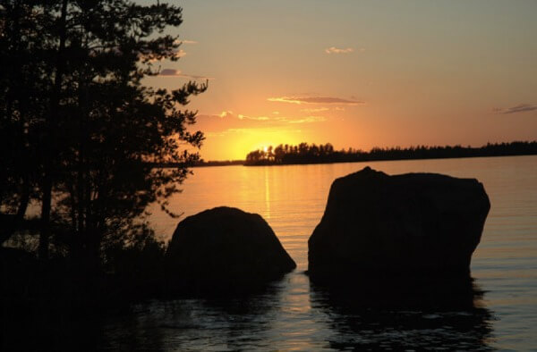 Viewing a beautiful sunset on Rainy Lake from a houseboat.