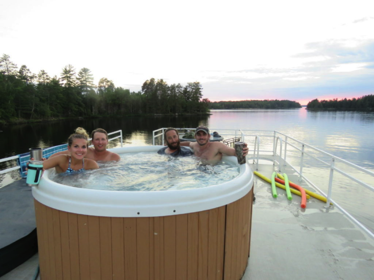 Friends enjoy hot tub at Rainy Lake